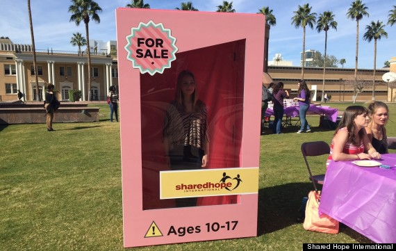Photo of To Warn Of Super Bowl Sex Trafficking Risks, Young Women Pose In Life-Size Toy Box