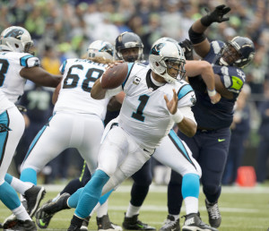 Panthers quarterback Cam Newton tries to get away from a collapsing pocket  in the first quarter during Monday Night Football at CenturyLink Field, Oct. 5, 2015.