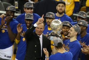 Former player Rick Barry, center, celebrates with members of the Golden State Warriors as they celebrate their win over Oklahoma City Thunder in Game 7 of the NBA Western Conference finals at Oracle Arena in Oakland, Calif., on Monday, May 30, 2016. (Aric Crabb/Bay Area News Group)