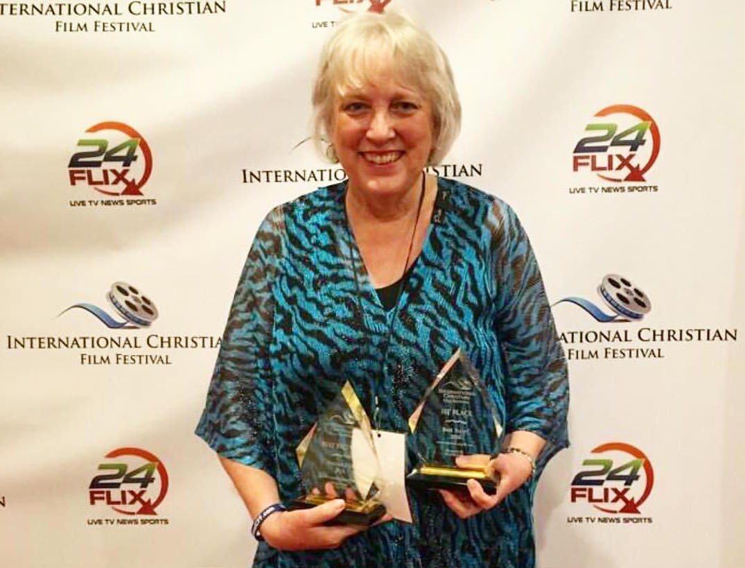 Producer Carolyn Linn Holds Best Picture and Best Script Awards