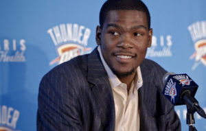 NBA BASKETBALL PLAYER: Oklahoma City Thunder's Kevin Durant smiles as he speaks during a press conference to officially announce Durant's five-year contract extension to play for the Oklahoma City Thunder on Friday, July 9, 2010, in Oklahoma City, Okla. Photo by Chris Landsberger, The Oklahoman ORG XMIT: KOD