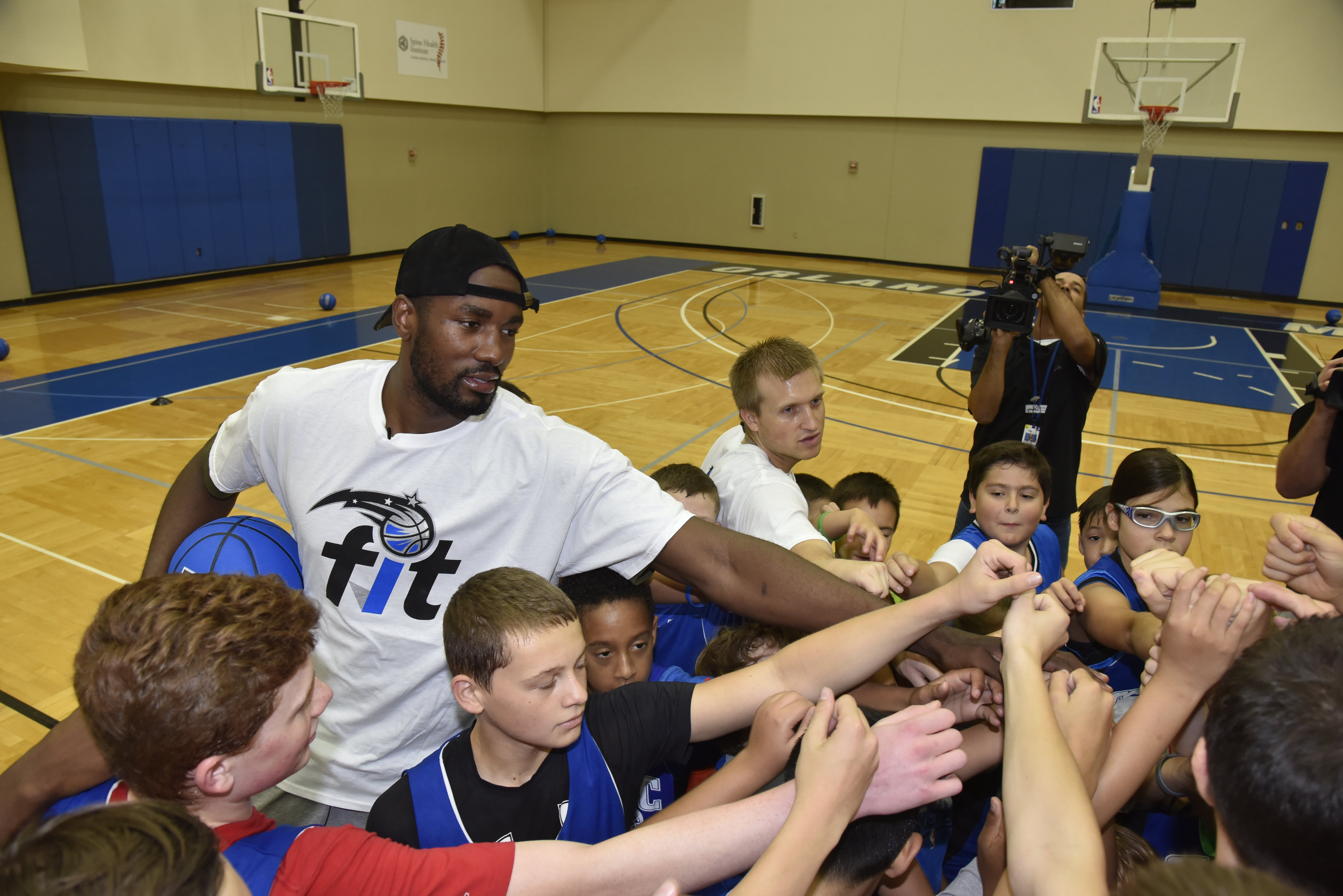 Photo of Orlando Magic's Serge Ibaka Takes Time Out For The Kids
