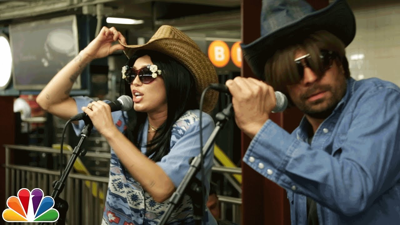 Photo of Miley Cyrus & Jimmy Fallon sings in NYC Subway in Disguise