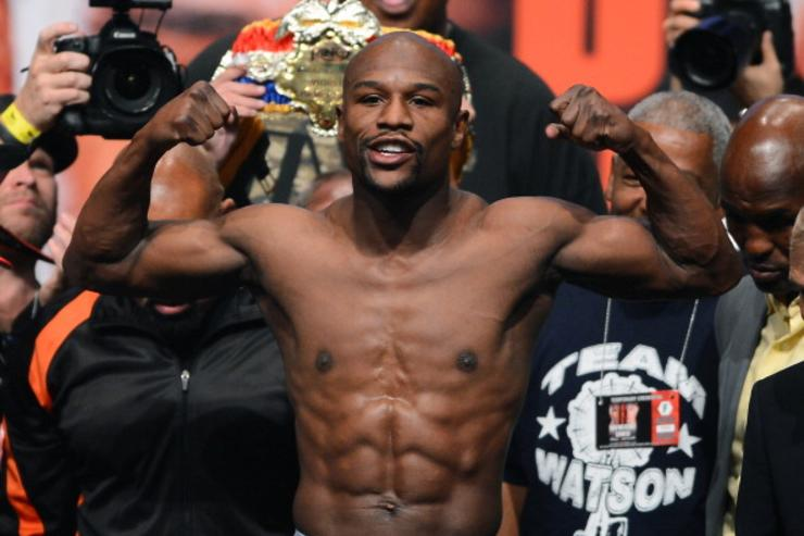 Photo of Floyd Mayweather remains undefeated (50-0)