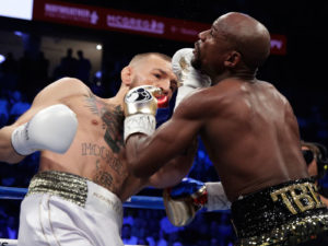 Floyd Mayweather remains undefeated (50-0)