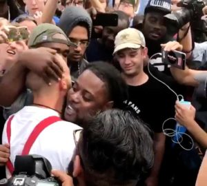 Black Protester Shows Nazi Who The Bigger Man Is
