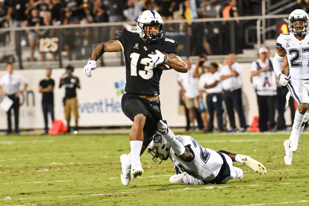 UCF Dominates UConn 56-21 in first conference game.