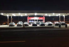 Photo of Car dealership invites homeless drivers to park on their lot overnight
